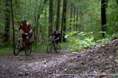 Two mountain bikers about to take on a steep switchback