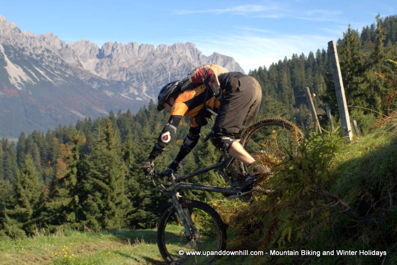 A short steep descent, rider over the back of his saddle. Good technique