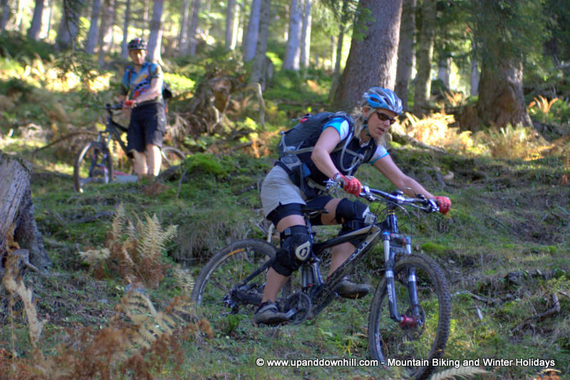 Female rider riding through a steep switchback section