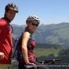 A couple mountain biking in the Alps