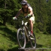 Jumping on a mountain bike on an alpine trail