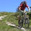 Mountain biker jumping on singletrack